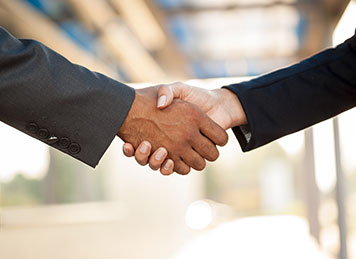 Two employees shaking hands